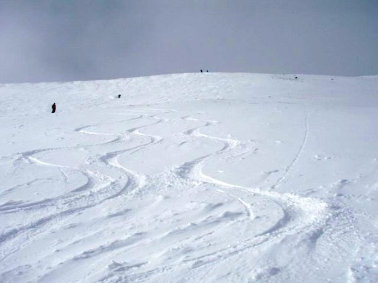 Ski Tracks in the Primer Bowl Run.  As is typical at Loveland, one can find untracked snow by traversing at the bottom of closed areas.